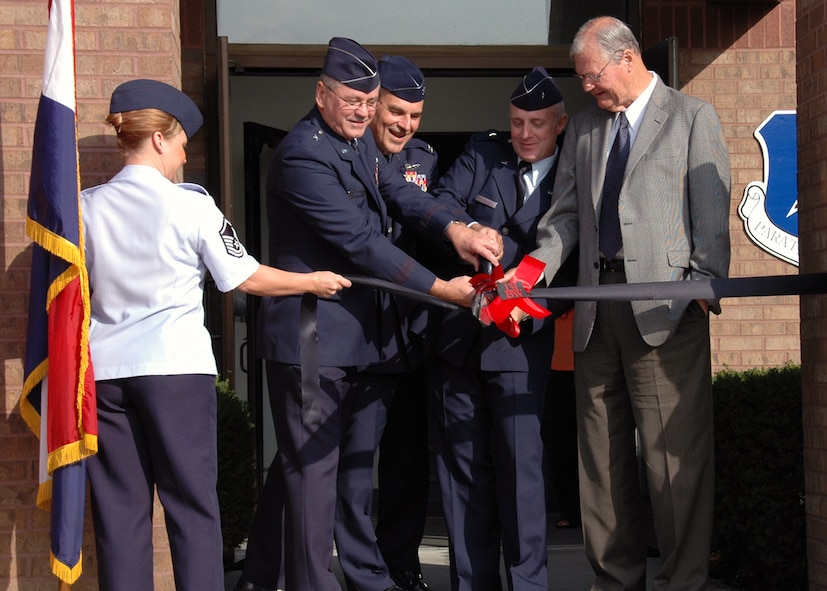 Brig. Gen. Craig D. McCord, Col. Robert L. Leeker, Brig. Gen. Garrett Harencak, and Congressman Ike Skelton participate in a ribbon cutting ceremony to commemorate the transition of the 131st Fighter Wing to the 131st Bomb Wing at Whiteman, AFB. (Photo By: Tech. Sgt. Megan Hunter)