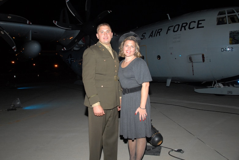 Capt. Matt Sala and his wife, Carie, stand in front of an LC-130 during the base's 60th Anniversary Hangar Dance on Oct. 4. Vintage World War II aircraft were also on display right outside the hangar. (U.S. Air Force photo by Master Sgt. Willie Gizara)