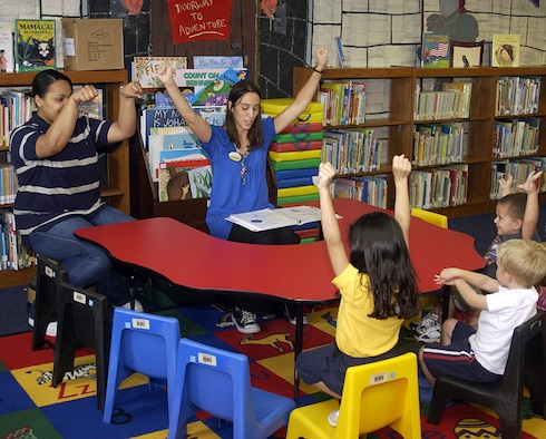 ANDERSEN AIR FORCE BASE, Guam - Christina Wray and Alicia Jackson, both librarian aides for the 36th Force Support Squadron, lead children in a rhyme with hand motions during Story Time at the Andersen Library Oct. 1. (U.S. Air Force photo by Airman 1st Class Carissa Wolff)