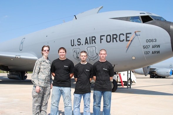 2nd Lt. Jacquelyn Stauffer, meets up with three new recruits destined for her section immediately before a mass enlistment ceremony is held in front of a KC-135R here at Tinker Air Force Base October 5.  The lieutenant is the Transportation Flight officer with the 507th Air Refueling Wing's Logistics Readiness Squadron. Pictured with her (left to right) is John Melton, who will be assigned to vehicle operations, Zack Setzer, vehicle maintenance and Dustin Payne, who will be assigned to the Logistics Plans section.  In all, 25 new recruits were sworn into the Air Force Reserve Command.  These new recruits will now head off for basic training and technical school.