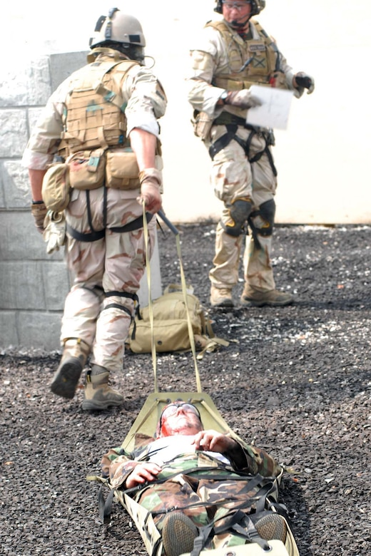 U.S. Air force photo of pararescuemen transporting a patient by litter during the Mass casualty exercise at the 2008 Para Rescue Rodeo hosted by the 123rd Special Tactics Squadron Kentucky Air National Guard. The rodeo consisted of Air Force, Air Force Reserve, Air National Guard and Canadian participants. During the weeklong event consisting of eight different teams they competed in five different areas. Mass casualty, Urban Tactical Personal Recovery, Confine Space, Rescue Jump Master, and the Canopy Accuracy event. The Main goal of the rodeo was competition, providing cross intelligence sharing and training in a simulated real life environment. (USAF Photo by MSgt Gerold O. Gamble) (released)