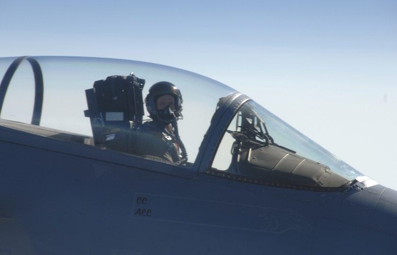 "Lt. Col. John ""Stick"" Abell, 110th Fighter Squadron pilot, flies his F-15 Eagle in Aerial Combat Maneuvers Sept. 25.  Colonel Abell was participating with other pilots from the 110th Fighter Squadron in the training. (Photo by Capt. Timothy Reinhart)"