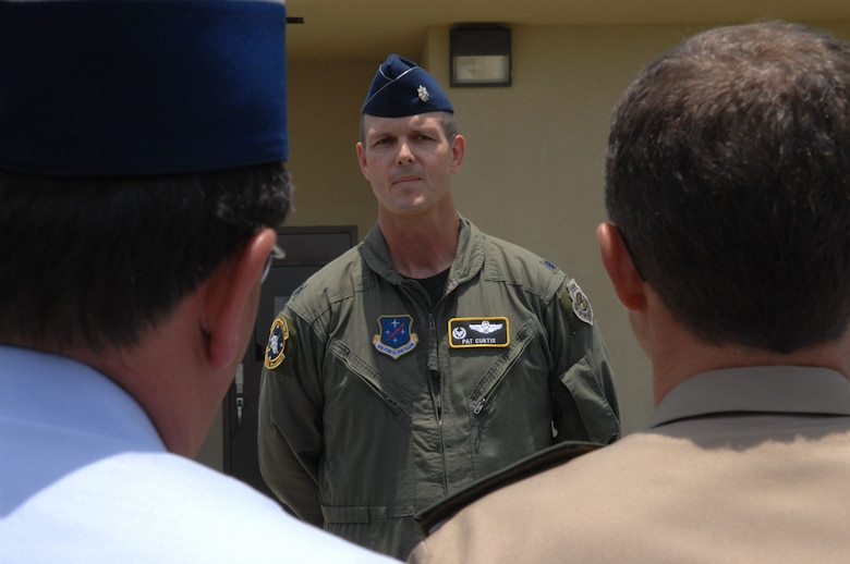 Lt. Col. Jared Patrick Curtis, 478th Expeditionary Operations Squadron commander, welcomes approximately 20 attaches and instructors to here October 3. The servicemembers represented 10 militaries throughout the world. (US Air Force photo/1Lt. Lauren Wright)