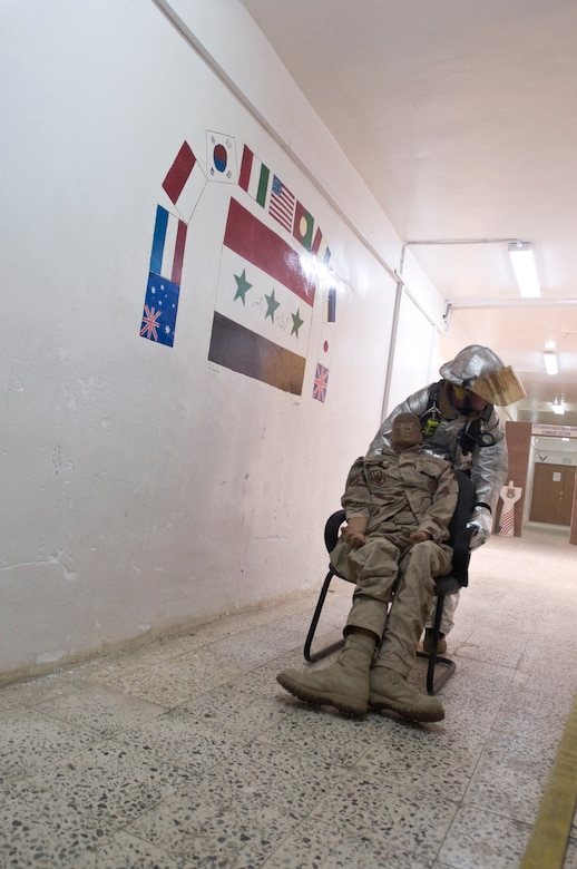 ALI BASE, Iraq -- Tech. Sgt. Andrew Vorlicek, 407th Expeditionary Civil Engineer Squadron fire fighter, drags a dummy away from a smoke-filled room Oct. 3, 2008. The 407th ECES fire fighters held a structural drill at the passenger terminal here evaluating from dispatch to the actual response itself. Vorlicek is deployed from 133rd Airlift Wing, Minnesota Air National Guard. (U.S. Air Force photo/Airman 1st Class Christopher Griffin)