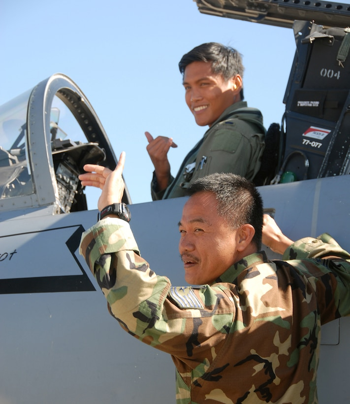 WILLIAMTOWN, AUSTRALIA --  Father, Tech. Sgt. Marconi Cabatbat Sr.,154th Logistics Readiness Squadron and son, 1st Lt. Marconi Cabatbat Jr., 199th Fighter Squadron,deploy together for the first time during Sentry Down Under 2008 held Sept. 3 - 22 in Williamtown, Australia. Tech. Sgt. Cabatbat has another son, Jason, who is also a member of the 154th Wing.