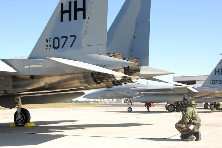 WILLIAMTOWN, AUSTRALIA -- A 154th Wing Maintenance Airman checks control surface operations during a pre-flight check during the second day of operations of Sentry Down Under in Williamtown, Australia.