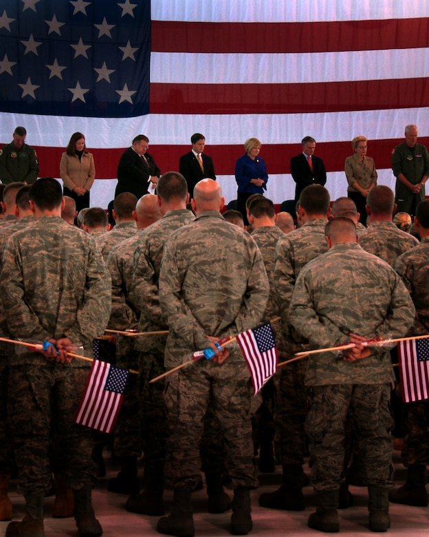 Members of the 180th Fighter Wing and distinguished guests bow their heads in prayer at the send-off ceremony October 5, 2008 to honor our servicemembers for thier upcoming deployment in support of Operation Enduring Freedom and Operation Iraqi Freedom. Photo by Airman First Class Amber Williams