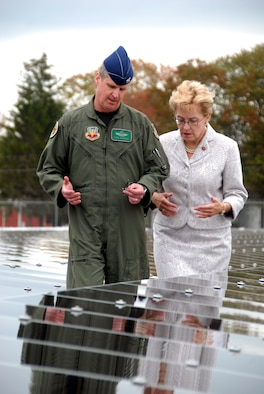 Col. Mark E. Bartman, 180th Fighter Wing Commander, Ohio Air national Guard and Congresswoman Marcy Kaptur walk among the rows of solar panels at the 180th Fighter Wing's Alternative Energy site on September 27, 2008. The solar field is part of the 180th FW's Renewable Energy Project, funded by the Department of Defense Research and Development Program in an effort to reduce the 180th's use of limited fossil fuel and dependence on foreign energy sources. Once completed, the solar field is expected to produce 800-900 Kilowatts of electricity, which will allow the 180th to save approximately 37.5% on the annual electricity budget. The solar field will also reduce the amount of coal burned to produce energy by almost 250 tons annually, while at the same time reducing harmful emissions and greenhouse gasses. USAF Photo by Senior Airman Jodi Joice (Released).