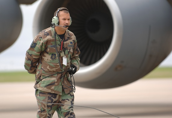 Tech. Sgt. Billy Martin, a crew chief assigned to the 931st Aircraft Maintenance Squadron, helps with the recovery of a KC-135 Stratotanker that returned from a mission during the 931st Air Refueling Group's September Unit Training Assembly. Plans to expand Sergeant Martin's squadron are close to final. (U.S. Air Force photo/Tech. Sgt. Jason Schaap)