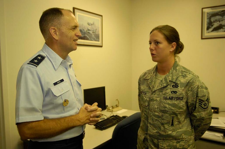 Maj. Gen. Ralph J. Jodice II (left), 320th Air Expeditionary Wing and Air Force District of Washington commander, meets with Staff Sgt. Angela R. Britton, Information Technology Support Technician. Sergeant Britton, from the 509th Communications Squadron at Whiteman Air Force Base, Mo., is deployed with the 320th AEW at Andrews AFB, Md., to support the 2009 presidential inauguration as part of the 56th Armed Forces Inaugural Committee. (U.S. Air Force photo)