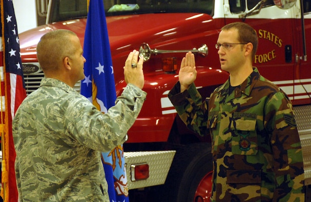 Staff Sgt. David Lokken, 14th Civil Engineer Squadron, takes the Oath of Enlistment from Lt. Col. Peter Ridilla, 14th CES commander. Sergeant Lokken reenlisted for an additional four years of service. (U.S. Air Force photo by Airman Josh Harbin)