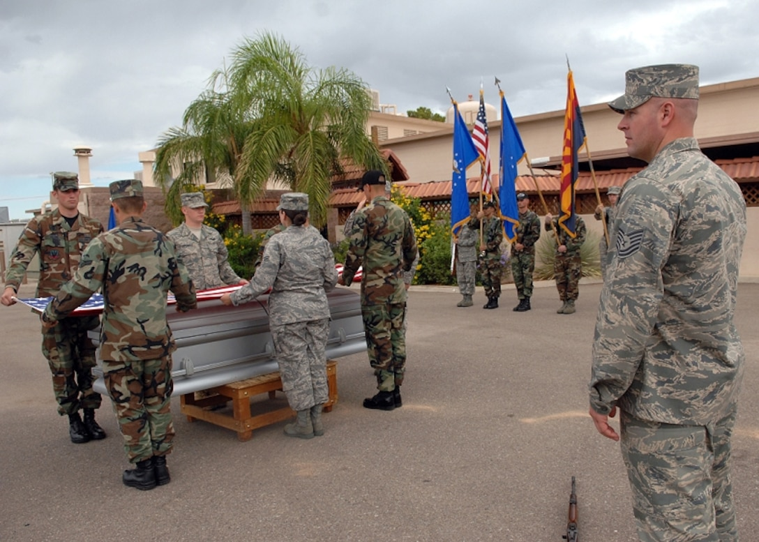 Tech Sgt. Toby Farr, right, U.S. Air Force Honor Guard formal training instructor, watches as base honor guardsmen practice a funeral sequence during a training visit to Davis-Monthan Air Force Base, Ariz. (Photo courtesy of U.S. Air Force Honor Guard)