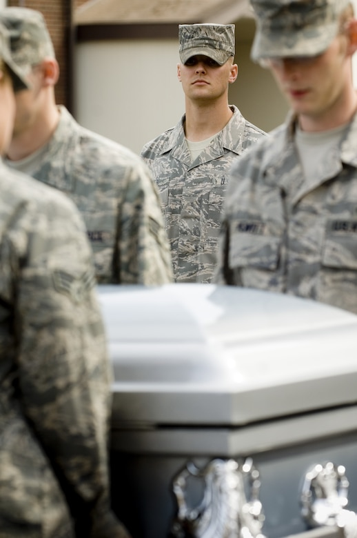 Staff Sgt. Alex Frizzo, U.S. Air Force Honor Guard formal training instructor, center, looks on as base honor guardsmen practice proper casket-carrying techniques during a recent visit to McChord Air Force Base, Washington. (Photo courtesy of U.S. Air Force Honor Guard)