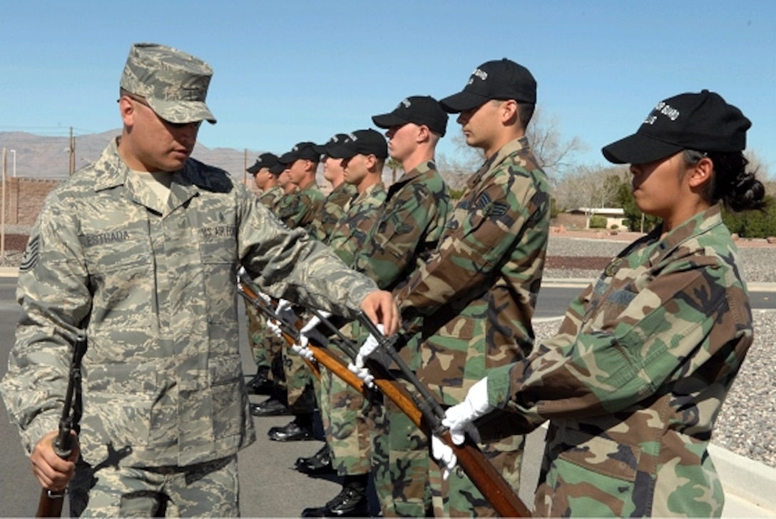 Tech Sgt. Jason Estrada, U.S. Air Force Honor Guard noncommissioned officer in charge of the Base Honor Guard Training Program, inspects base honor guardsmen's Ceremonial rifles at Nellis Air Force Base, Nev., during a recent training visit. (Photo courtesy of U.S. Air Force Honor Guard)