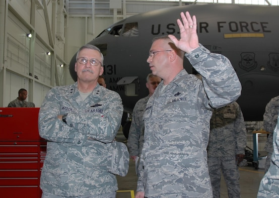 MCGUIRE AIR FORCE BASE, NJ - Maj. Gen. Martin M. Mazick, commander, 22nd Air Force, Dobbins Reserve Air Base, Ga., looks on as Senior Master Sgt. Robert Henderson, 514th Air Mobility Wing Maintenance Squadron, Maintenance Flight Chief, explains the Home Check Station process.  The HCS process is an in-depth scheduled inspection of aircraft systems and is an Air Mobility Command benchmark for which the 305th Air Mobility Wing and 514th MXS won the AMC Chief of Staff Excellence award this year. General Mazick met with members and toured various units throughout the wing during his October visit. (U.S.Air Force photo/Staff Sgt. Monica Dalberg)