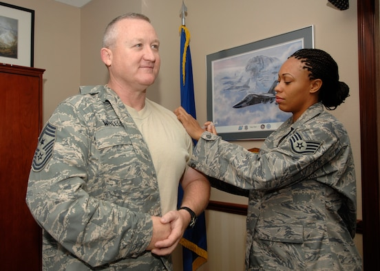 Chief Master Sgt. Paul Wheeler, Air Force District of Washington command chief, receives his flu shot from Aerospace Medical Technician Staff Sgt. Latoya McGee, from the 779th Medical Operation Squadron, Allergy/Immunization Clinic, Andrews Air Force Base, Md. Flu vaccinations this year are being combined with Individual Medical Readiness screenings for all AFDW Airmen assigned to Andrews. Screenings will occur Oct. 21 thru 23 from 7 a.m. to 7 p.m. at the Andrews base theater. In addition to the flu vaccination, public health, dental and immunizations readiness requirements  will be reviewed. Flu shots are recommended for all Airmen. According to the Centers for Disease Control and Prevention, each year in the United States more than 200,000 people are hospitalized and more than 36,000 people die from flu complications.