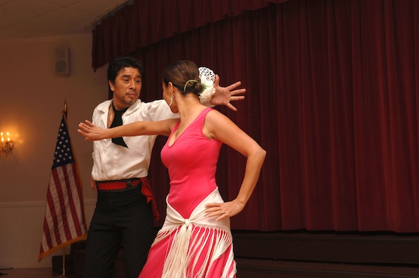 Jeny and Faustino Rios dance the Flamenco during the Hispanic Heritage luncheon Oct. 14 at the Surf's Edge Club here. More than one hundred people came to the Hispanic Heritage Luncheon which featured authentic Hispanic food and a guest speaker who spoke about his heritage. (U.S. Air Force photo by Senior Airman Rachel Cunningham)