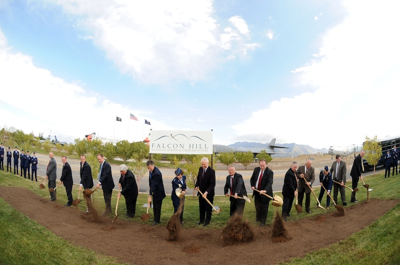 Dignitaries lift shovelfuls of dirt to commemorate the groundbreaking for the Falcon Hill Aerospace Development Park here Oct. 10. (U.S. Air Force Photo by James Arrowood)