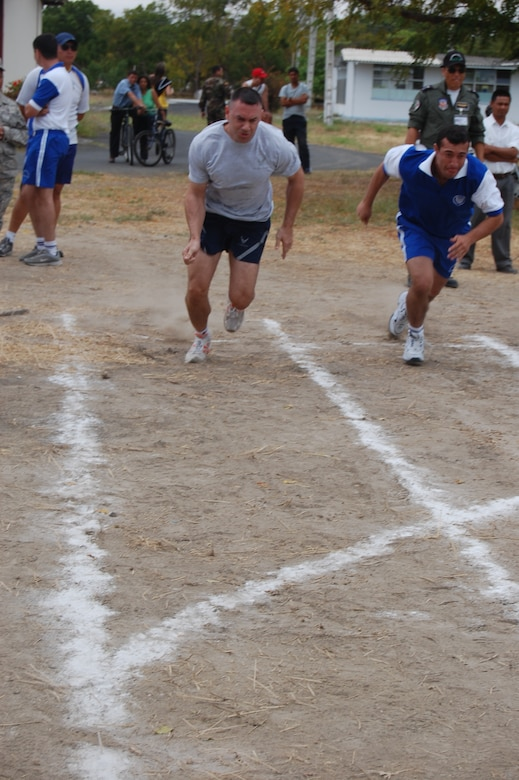 FORWARD OPERATING LOCATION MANTA, Ecuador -- Master Sgt. Mark Miller, 478th Expeditionary Operations Squadron chief of intelligence operations, runs the 100-meter dash during the Ecuadorian Air Force sports competition. Sergeant Miller won the race, the first in a six-week competition featuring basketball, volleyball, soccer and track events. (US Air Force Photo/1Lt. Lauren Wright)