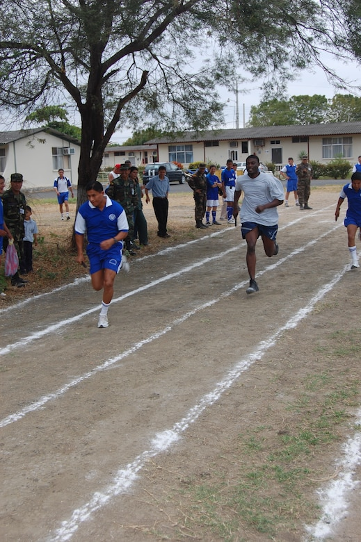 FORWARD OPERATING LOCATION MANTA, Ecuador -- Staff Sgt. Anthony Snell, 478th Expeditionary Operations Squadron security forces member deployed from Holloman Air Force Base, N.M., competes in the first leg of a 4x300-meter relay during the Ecuadorian Air Force sports competition. The six-week competition features basketball, volleyball, soccer and track events. (US Air Force Photo/1Lt. Lauren Wright)