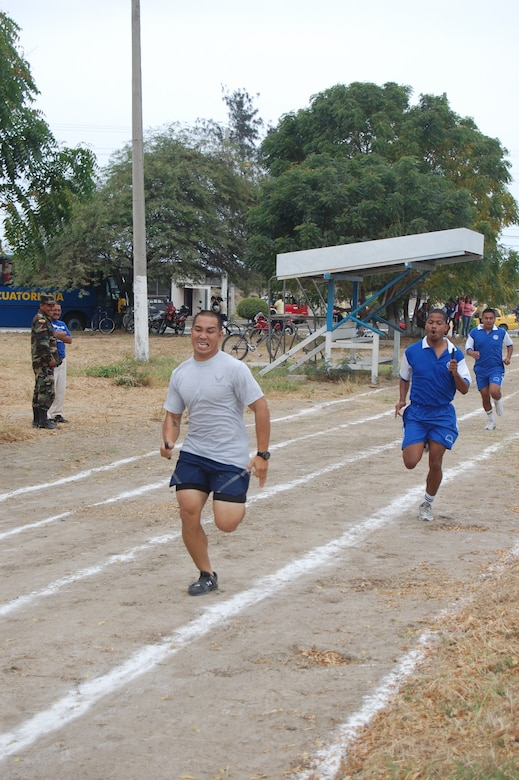 FORWARD OPERATING LOCATION MANTA, Ecuador -- Senior Airman William Bullicer, 478th Expeditionary Operations Squadron security forces member, deployed from Holloman Air Force Base, N.M., competes in a leg of the 4x300-meter relay competition at the Ecuadorian Air Force sports competition. The six-week competition features basketball, volleyball, soccer and track events. (US Air Force Photo/1Lt. Lauren Wright)