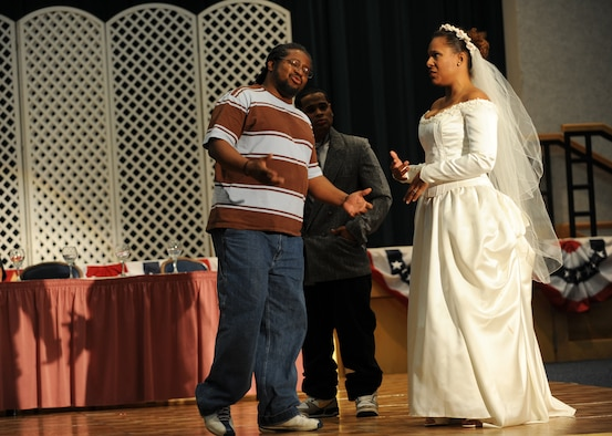 "Anise Abdul-Hameed tries to reason with the bride during a dress rehearsal of ""The Wedding Song,"" a murder mystery play put on by the McConnell Players. Abdul-Hameed, a computer network administrator for the 931st Air Refueling Group, is a new member to the community theater group. The show is scheduled to start at 6 p.m. tonight. (U.S. Air Force photo/Tech. Sgt. Jason Schaap)"