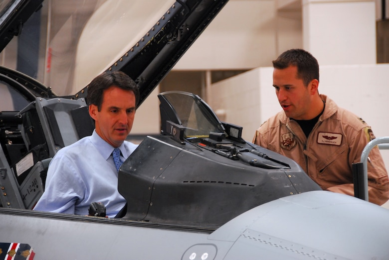 148th Fighter Wing pilot Capt. Thomas Rendulich explains about the cockpit of an F-16 Fighting Falcon to Minn. Governor Tim Pawlenty in Duluth, Minn October 16, 2008.  (U.S. Air Force photo by TSgt Jason Rolfe) (Released)