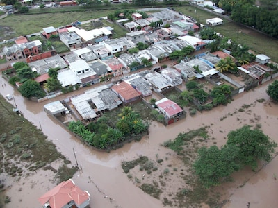 An aerial view of the area affected by the flood in Comayagua, Honduras, Oct. 19. A Emergency Response Team from Soto Cano Air Base rescued four people from the flood waters.