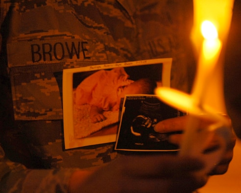 Senior Airman Ashlee Browe, 779th Medical Group Aerospace Medical Service Apprentice, holds a lighted candle in memoriam of her daughter Fallyn Averie-Hope Browe Oct. 15 at Chapel 3. Fallyn was born full term on Jan. 17, 2008 at 6 lbs 12 oz but passed away due to underdeveloped lungs and a displaced heart.  (U.S. Air Force photo/Senior Airman Steven R. Doty)