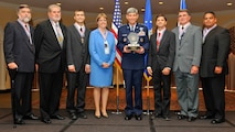 General Norton Schwartz, U.S. Air Force chief of staff, awards the 2008 Chief of Staff Team Excellence Award to the Nellis Solar Power Team at the Omnishore Hotel, Washington DC, Sep. 16. Pictured from left to right are James Snook, Air Force Civil Engineer Support Agency, Gene Rogers, Nellis deputy base civil engineer, Jeffrey Blazi, Nellis AFB utility manager, Lt. Col. Karen White, AFCESA, Gen. Schwartz, Steven Dumont, Air Combat Command, Tomas White, ACC, David Robledo, Nellis project contracting officer.  Members not pictured are Lynn Haarklau, National Environmental Policy Act  manager, and Michelle Price, Nellis energy manager. (courtesy photo)
