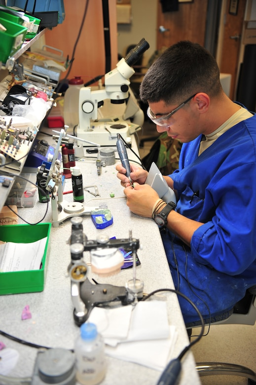 Senior Amn Richard Sandoval, 355th Dental Squadron dental laboratory technician, fabricates a parcelain crown for a patient here, October 17. (U.S. Air Force photo/Senior Airman Noah R. Johnson)