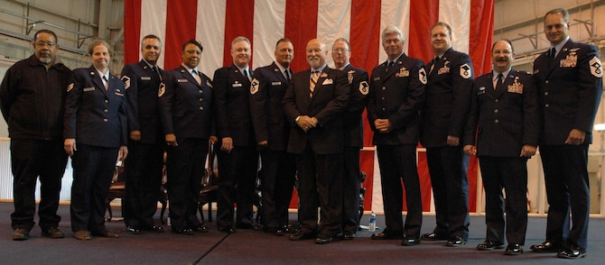 MCGUIRE AIR FORCE BASE, NJ -- Retired members of the 514th Air Mobility Wing join wing leaders and guest speaker Col. (Ret.) Seamus McCaffrey (center wearing suit) during a recent annual retirement ceremony held here. The Reserve members each received a retirement certificate from the Chief of Staff of the Air Force and a certificate of appreciation from President George W. Bush. (U.S. Air Force photo/Senior Airman William P. O'Neil III)