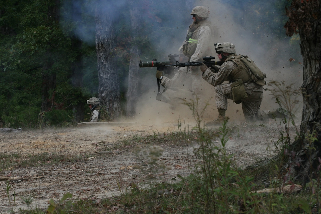 Marines with 2nd Battalion, 8th Marines, 2nd Marine Division, fire a shoulder-launched multipurpose assault weapon during a field exercise, Oct. 23, on a platoon assault range here.  The battalion was here for about a month conducting pre-deployment training.  The five companies in the battalion took aim on five different ranges throughout the training which consisted of a platoon assault course, vehicle mounted heavy machine gun courses, mortar ranges, combat marksmanship program courses, and a known distance course. ::r::::n::