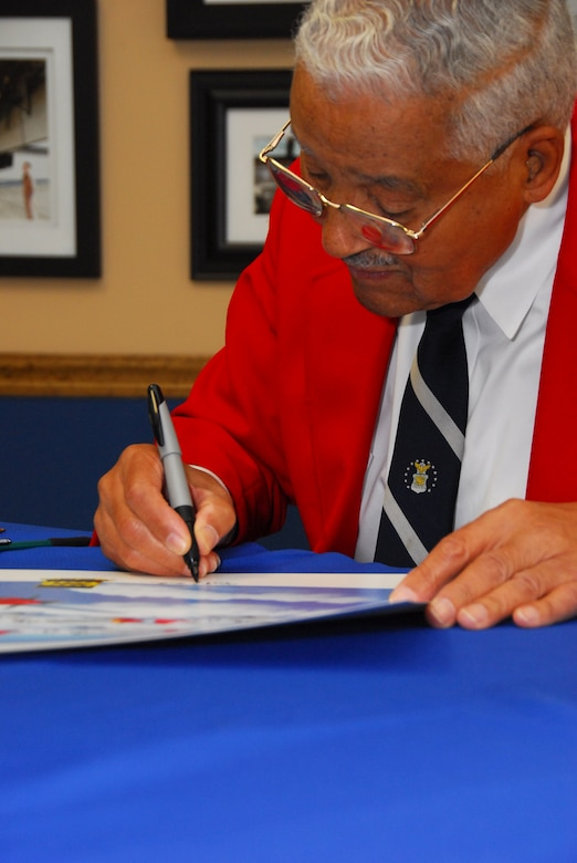 Retired Col. Charles McGee, one of the original Tuskegee Airmen, signs autographs after speaking to Squadron Officer School students at the Warrior Symposium Oct. 16.  (Air Force photo by Scoot Knuteson)