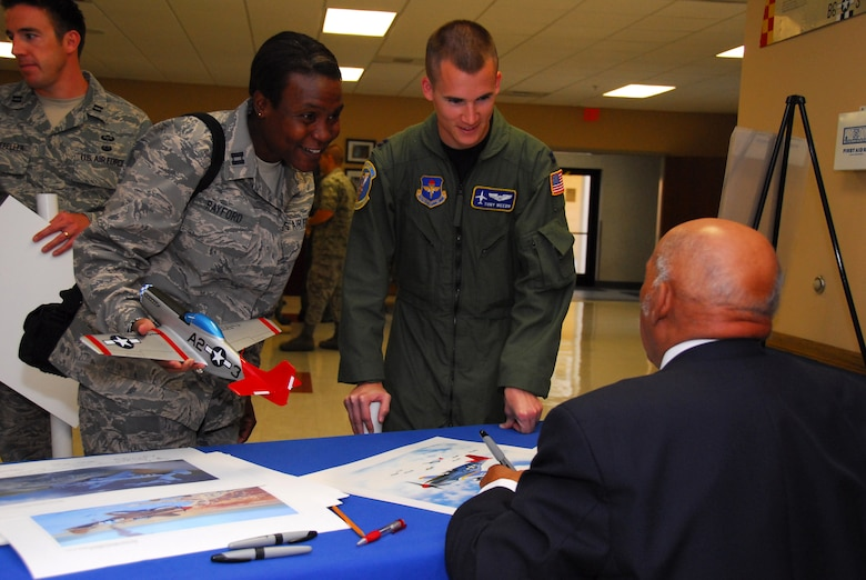 Capt. Roslynn Rayford and Capt. Tony Weedn speak to retired Lt. Col. William Holloman, one of the original Tuskegee Airmen who addressed scores of captains completing their training at Squadron Officer School.  (Air Force photo by Scoot Knuteson)
