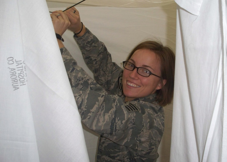 WARRIOR OF THE WEEK -- Staff Sgt. Elizabeth Foley, a housing manager for unaccompanied members from the 460th Civil Engineer Squadron, helps set up the 460th CES Slaughter House -- the CES's version of a haunted house. Sergeant Foley is Team Buckley's Warrior of the Week for Oct. 24 - 30. (Courtesy photo)