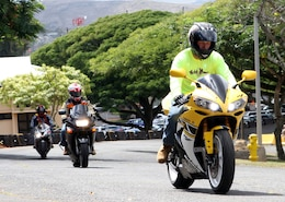 """Sgt. Robert Manion, training's nuclear, biological and chemical chief for Headquarters and Service Battalion, U.S. Marine Corps Forces, Pacific and one of the """"Ride Safe Club"""" founders, leads the pack of sports bikes toward the base's front gate for their monthly ride Oct. 24."""