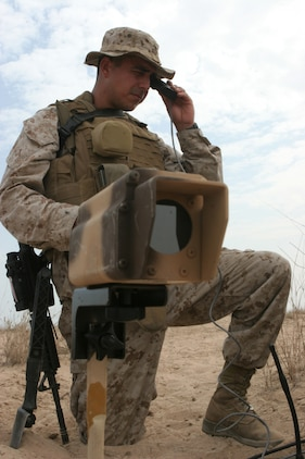 Lance Cpl. Jaime J. Sweeney, radio operator for the 26th Marine Expeditionary Unit's Ground Sensor Platoon, checks the field of view from a camera, Oct. 24, 2008, in the Middle East.  The 26th MEU was conducting bilateral training exercises with the host nation.