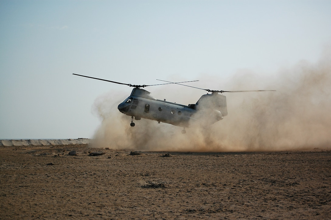 Colonel Mark Desens, 26th Marine Expeditionary Unit commanding officer, brings in a CH-46E Sea Knight helicopter to a dusty landing at one of many training sites during a recent bilateral training exercise. Desens conducted a leader's recon of the entire training area, spanning three points more than 50 miles apart each.