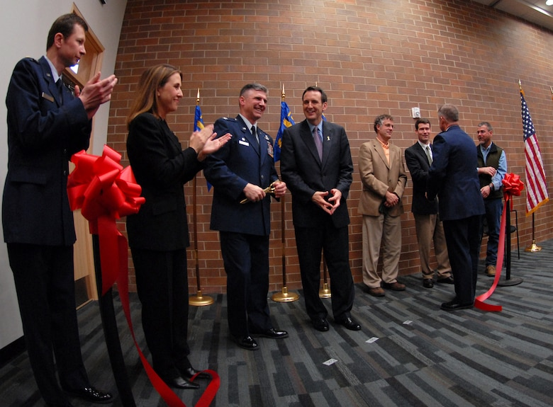 The official red ribbon drops severed to the ground, a testament to the meticulous planning and construction that has occurred to make the new composite maintenance building at the 133rd Airlift Wing in Saint Paul a facility to be proud of. (From left to right: Team designers Maj. Michael Piontek and Ms. Barbara O'Brien, 133rd Airlift Wing Commander Col. Greg Haase, Gov. Tim Pawlenty, and  the Assistant Adjutant General of Air, Brig. Gen. Timothy Cossalter.)