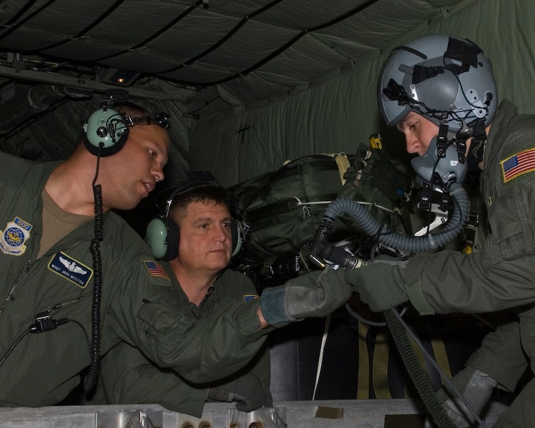 Loadmasters from the 109th Airlift Squadron check the oxygen system during training in a MN Air National Guard C-130H using the Joint Precision Air Drop System, or JPADS, on June 18, 2008.