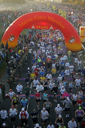 Thousands of runners surge past the starting line of the 33rd Marine Corps Marathon on Jefferson Davis Highway Oct. 26. The marathon started in 1976 with 1,175 finishers.