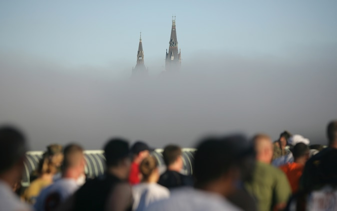 Spires from Georgetown University rise above the early-morning fog from the Potomac River while runners cross the Key Bridge during the 33rd Marine Corps Marathon Oct. 26. Hundreds of spectators were also present on the bridge to cheer on the marathoners.