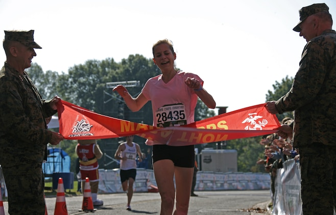 Cate Fenster, 37, was the first female to finish the 33rd Marine Corps Marathon. Fenster crossed the finish line with a time of 2:48:55. It was the first marathon the Wooster, Ohio, native ran.
