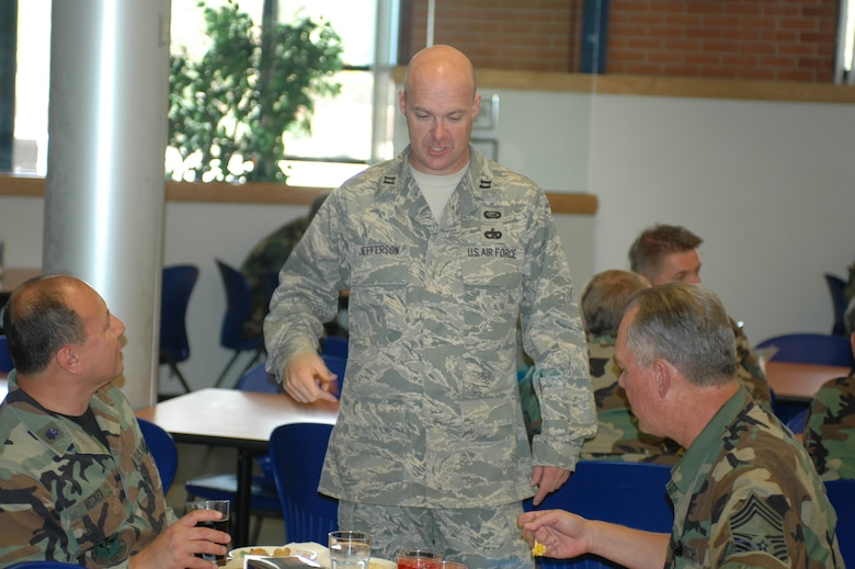 Capt. Paul Jefferson, service's commander, talks with Chief Master Sgt. Russell Sullivan and Lt. Col. Chuck Recker about their lunch. Captain Jefferson makes sure the food is good, and served with the appropriate portions. Services has to meet Air Force standards within plus or minus 10 percent. That means they are not able to make or lose much money. Monitoring portions is one way they are able to successfully meet rigid standards. (Air National Guard photo by 1st Lt. Dan Dodson)