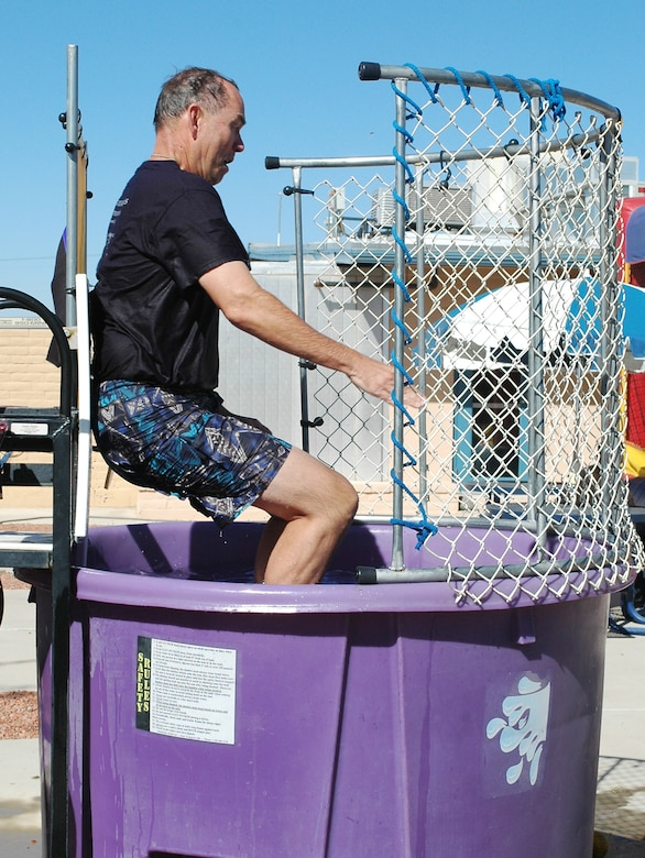 Brig. Gen. Rick Moisio, wing commander, is dropped into a dunk tank during the 162nd Fighter Wing's Haunted Hangar, Oct. 26. Several wing leaders volunteered for the tank to raise funds for the Family Readiness Group. (Air National Guard photo by Capt. Gabe Johnson)