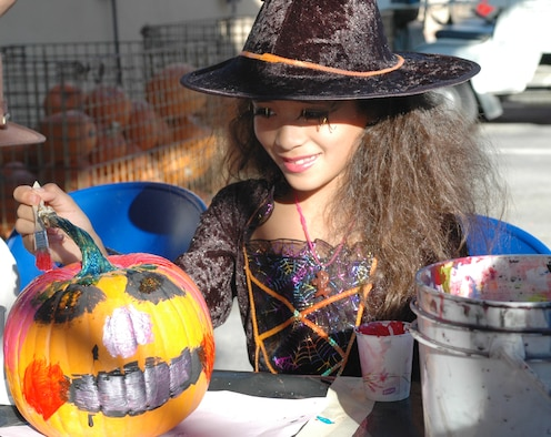 Mikala Highbaugh, 8, niece of Master Sgt. Claudia Austin-Hadley, paints a pumpkin at the 162nd Fighter Wing's Haunted Hangar event, Oct. 26. Pumpkins were donated from Mrs. Moose's Pumpkin Patch and Buckelew Farms (Air National Guard photo by Capt. Gabe Johnson)