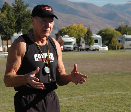 Roger Reynolds, director of contact relations at the Cooper institute, discusses proper form while running to a group of physical training leaders Oct. 24.