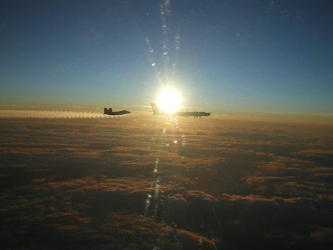 """Two F-22 Raptors from 11th Air Force, 3rd Wing, based at Elmendorf Air Force Base, Alaska intercepted a pair of Russian Tu-95MS strategic bombers on November 22, 2007.  Both """"Bears"""" belong to the 326th Heavy Bomber Air Division and are operated from Ukrainka air base.  The intercept was a first for the Raptor.  (U.S. Air Force photo)"""