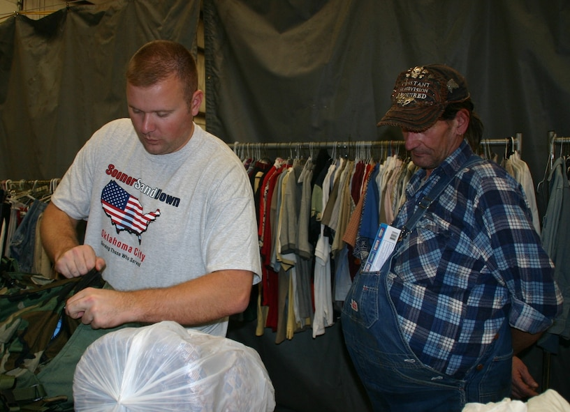 Staff Sgt. David Bizeau, 72 Contracting Squadron, helps a veteran fill his backpack with clothing and necessities. Photo courtest of 1Lt Kinder Blacke.